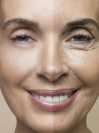 Studio shot of smiling middle-aged woman with both smooth and wrinkled skin