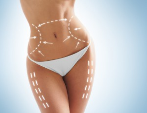 Beautiful and fit female body with the drawing arrows. Plastic surgery, healthy nutrition, liposuction, sport and cellulite removal concept.